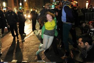 Cecily McMillan being arrested as the NYPD clears Zuccotti Park during a six-month memorial celebration of the Occupy Movement in March 2012
