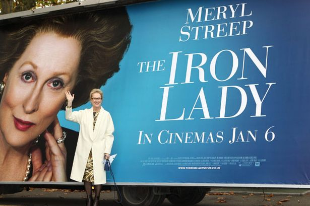 meryl-streep-poses-with-the-iron-lady-billboard-pic-getty-567547143